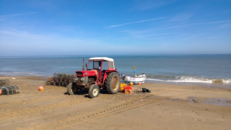 Crab boats going out for the first time this year at Cley Beach