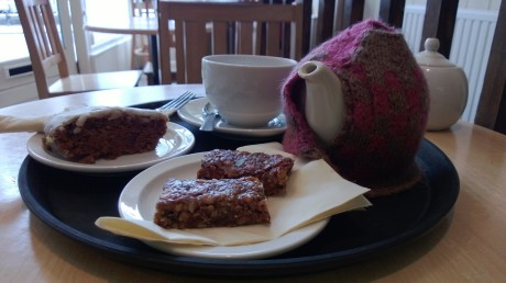 Ginger & lemon cake, granola bar & tea in a tea cosy at Huckleberries in Cromer
